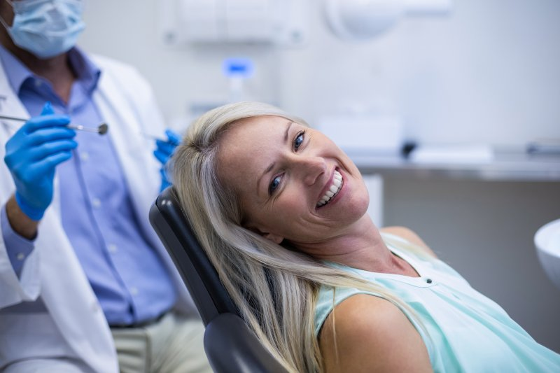 Woman smiling at routine dentist's appointment