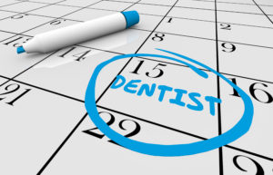 Closeup of calendar reminding patient of upcoming dental checkups