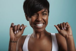 Woman flossing for her New Year's resolution
